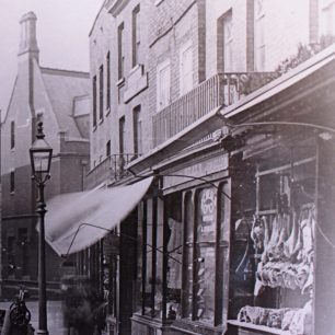 High St, Late 19th Century, showing butchers on right | from Wisbech and Fenland Museum (ref MS 248)