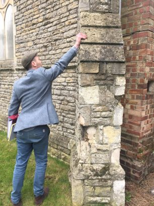 Stonemason assessing repairs | Taleyna Fletcher