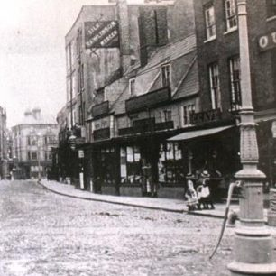 late C19th photo showing ad for Rawlinsons at No 12 | from Wisbech and Fenland Museum (Stanton Album)
