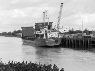 A view of 'SANDAL' being unloaded seen from the flood defence wall on West Parade | Dean Rocker