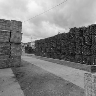'SANDAL' just visible behind stacks of imported timber | Dean Rocker