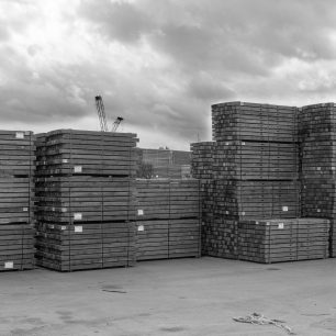 The stacks of timber build up as the cranes work busily unloading 'SANDAL' | Dean Rocker