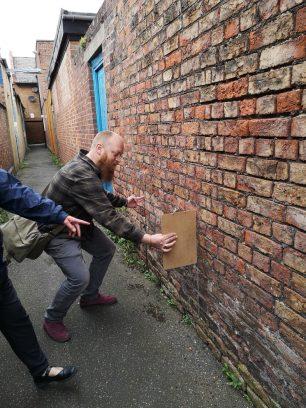 Neil examining brickwork | Lorena Hodgson